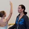 Evelyn Cisneros-Legate, right, helps Rachel Sorenson, 12, of Salem during class at the Lynch/van Otterloo YMCA. David Le/Staff Photo