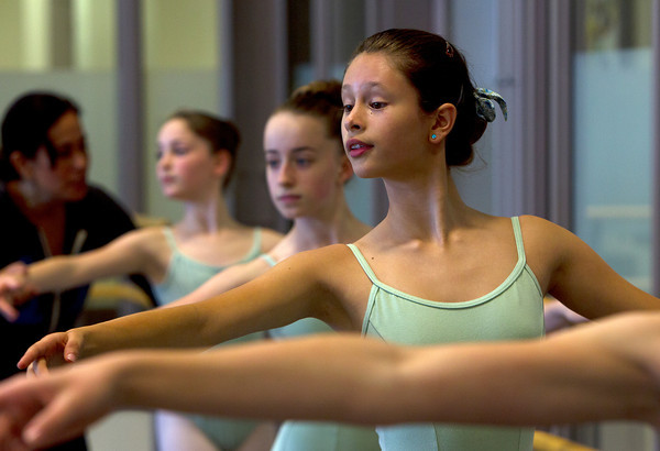 Marblehead native Adriana Termeer, 12, will be a Soldier Girl in the Boston Ballet's The Nutcracker this winter. Termeer goes through warm-up excersizes during class at the Boston Ballet School at the Lynch/van Otterloo YMCA in Marblehead.David Le/Staff Photo