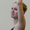 Emily Jelinek, 16, of Topsfield warms up during class at the Boston Ballet School at the Lynch/van Otterloo YMCA in Marblehead. David Le/Staff Photo