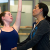 Evelyn Cisneros-Legate, right, instructs Julianna Mooney, 17, of Beverly, during class at the Lynch/van Otterloo YMCA. David Le/Staff Photo