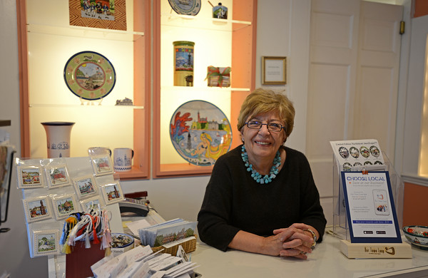 RYAN HUTTON/ Staff photo<br /> Hestia Creations' owner Joanne D'Alessandro stands behind the counter of her shop on Hawkes Street in Marblehead.