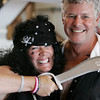 KEN YUSZKUS/Staff photo.  Volunteer Lori McHugh, also known as Dot the Dangerous, a port pirate and host captain Rick Fishkin, both from Marblehead, ham it up for photos at the Sailing Heals Pirates and Princesses Treasure Hunt Adventure held at the Boston Yacht Club in Marblehead.     06/29/16