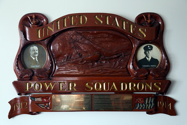 DAVID LE/Staff photo. The Boston Yacht Club is highly decorated with many plaques and trophies.