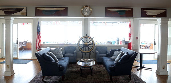 DAVID LE/Staff photo. The front hall of the Boston Yacht Club has inviting couches with a great view.