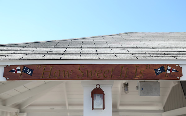 "DAVID LE/Staff photo. A ""How Sweet It Is"" wooden accent hanging at the Boston Yacht Club."