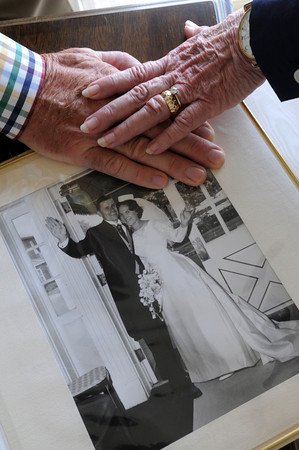 MARBLEHEAD HOME AND STYLE Magazine:<br /> Judy and Gene Jacobi will celebrate their 50th anniversary in August 2013. Their wedding photo album is opened to the photo of them on their wedding day.<br /> Photo by Ken Yuszkus , Friday, July 19, 2013.