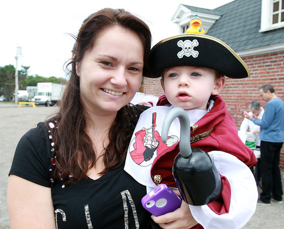 Marblehead: Rachael Roque, of Orlando, FL, and her son Alex, 2, at the Dress and Talk like a Pirate Rubber Duck Race. David Le/Marblehead Home & Style Magazine