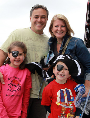 Marblehead: From left, Anna, 8, Jason, Sandra, and Jake Bobowski, 6, of Marblehead at the Dress and Talk like a Pirate Rubber Duck Race. David Le/Marblehead Home & Style Magazine