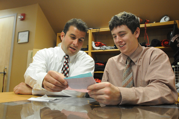 MARBLEHEAD HOME AND STYLE Magazine:<br /> Branch manager Matthew Martin, left, works with student Jason Harris at the National Grand Bank branch at Marblehead High School.<br /> <br /> Photo by Ken Yuszkus/Salem News,  Monday May 20, 2013.