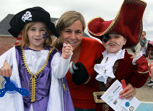 Marblehead: Deena Flaherty, of Marblehead, with her children Ainsley, 5, and JP, 3,  at the Dress and Talk like a Pirate Rubber Duck Race. David Le/Marblehead Home & Style Magazine