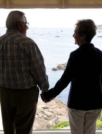 MARBLEHEAD HOME AND STYLE Magazine:<br /> Judy and Gene Jacobi will celebrate their 50th anniversary in August 2013. They are holding hands in front of one of their windows at their home.<br /> <br /> Photo by Ken Yuszkus , Friday, July 19, 2013.