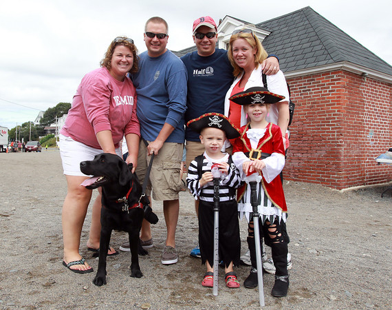 Marblehead: From left, Megan and Mark Milan, of Marblehead, and Greg, Danielle, Chase, 3, and Morgan Kulicki, 7, of Sandown, NH, at the Dress and Talk like a Pirate Rubber Duck Race. David Le/Marblehead Home & Style Magazine