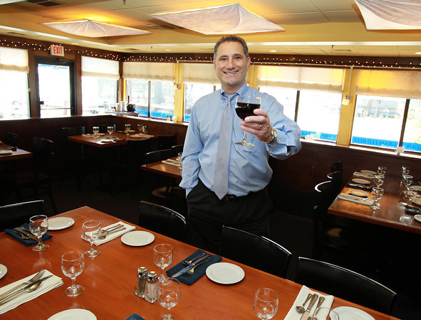 Marblehead: Robert Simonelli, is the General Manager and a Partner of The Landing Restaurant at 81 Front Street in Marblehead. The Landing offers a beautiful view of Marblehead Harbor right off the back porch and an inside platform area that seats 50. David Le/Marblehead Home and Style