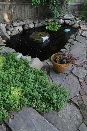MARBLEHEAD HOME AND STYLE Magazine:<br /> The fish pond with a fountain at the home of Artha Gerland at 11 Manataug Trail in Marblehead.<br /> <br /> Photo by Ken Yuszkus / Salem News, Friday, July 12, 2013.