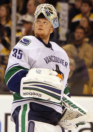 Vancouver Canucks goalie and Marblehead native Cory Schneider looks up at the scoreboard during a timeout. David Le/Staff Photo