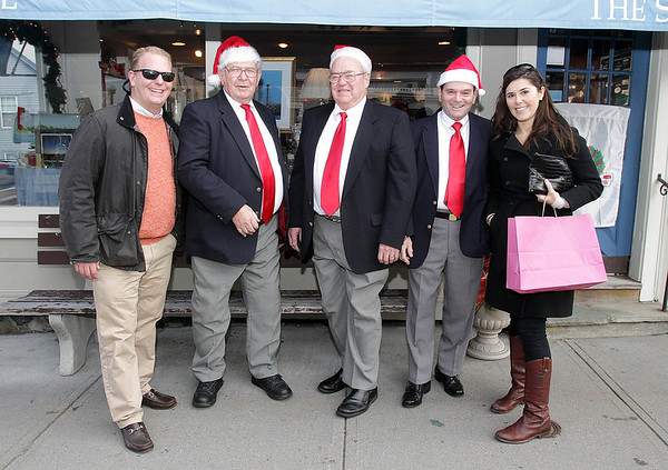 From left, Matt Olson, Jack Dowd, John Sketchley, Ray Deschamps, and Bianca Olson in downtown Marblehead during the 2011 Christmas Walk. David Le/Marblehead Magazine