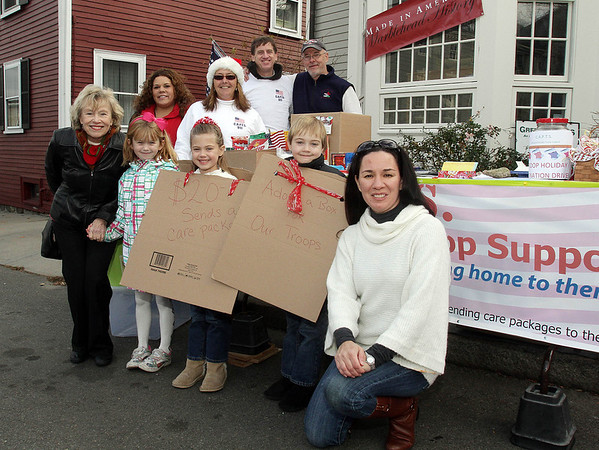 Front Row from left: Joy Shell, of Salem Hayley Love, 7, of Salem, Remington, 6, Everest, 6, and Maria Tilkens-Atkinson, of Marblehead. Back Row from left: Jill Birtwell, Janet Brings, Mark Brings, and Chet Strout, all of Marblehead along Washington St. during the 2011 Christmas Walk. David Le/Marblehead Magazine