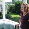 Marblehead:<br /> Karin is standing on her backyard deck which overlooks her backyard and patio garden ( not pictured ) in Karin McCarthy's garden at 15 Cloutmans Lane. <br /> Photo by Ken Yuszkus/Salem News, Tuesday, September 13, 2011.
