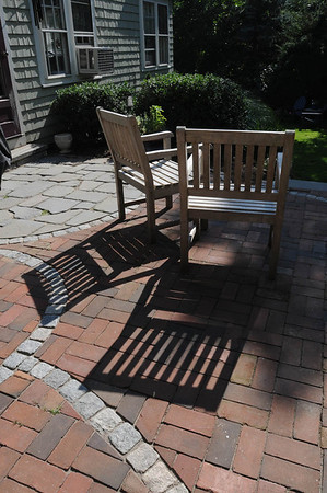 Marblehead:<br /> Shadows are cast across the backyard patio area at Karin McCarthy's home at 15 Cloutmans Lane. <br /> Photo by Ken Yuszkus/Salem News, Tuesday, September 13, 2011.