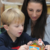Marblehead:<br /> <br /> This was used in the Salem News. <br /> <br /> Hayden Gallo, 4, and his mother, Melissa Gallo, build a gingerbread house during the gingerbread house workshop at the Marblehead Museum. One of two workshops which are part of the Marblehead Christmas Walk. <br /> Photo by Ken Yuszkus/Salem News, Tuesday, November 29, 2011.