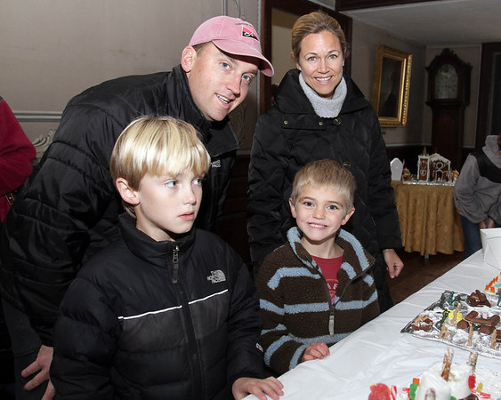 Brian and Hether Danforth of Marblehead, with their sons Porter, 8, left, and Zander, 6, right, at the Lee Hooper Mansion during the 2011 Christmas Walk. David Le/Marblehead Magazine
