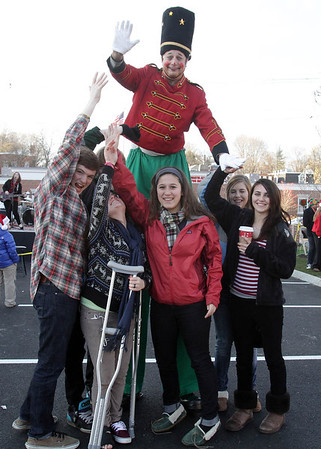 Dondo the Clown with some local Marblehead teens outside National Grand Bank on Pleasant St. during the 2011 Marblehead Christmas Walk. David Le/Marblehead Magazine