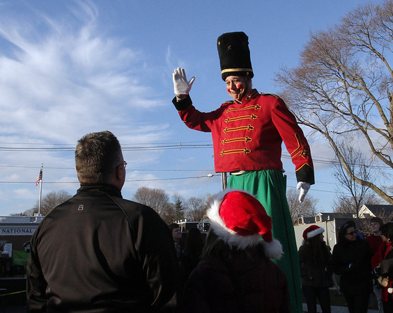 Dondo the Clown waves to the crowds near National Grand Bank on Pleasant St. during the 2011 Christmas Walk. David Le/Marblehead Magazine