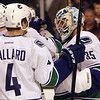 Vancouver Canucks goalie and Marblehead native Cory Schneider gets congratulated by Keith Ballard after Schneider defeated the Boston Bruins in rematch of the 2011 Stanley Cup. David Le/Staff Photo