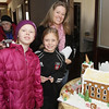 Carolyn Kendrigan, of Andover with her daughters Katelyn, 10, left, and Ashley, 8, middle, at the Lee Hooper Mansion during the 2011 Christmas Walk. David Le/Marblehead Magazine