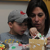 Marblehead:<br /> Colton Downey, 3, and his mother, Andrea Downey, build a gingerbread house together during the gingerbread house workshop at the Marblehead Museum. One of two workshops which are part of the Marblehead Christmas Walk. <br /> Photo by Ken Yuszkus/Salem News, Tuesday, November 29, 2011.