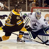 Vancouver Canucks goalie and Marblehead native Cory Schneider makes a save on Boston Bruins center David Krejci (46) as Canucks foward Ryan Kesler (17) pursues. He played against the hometown Boston Bruins on a visit to the Garden in January. David Le/Staff Photo