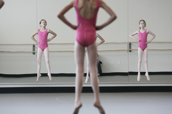 Marblehead: From left, Adrianna Temeer, Lara Turner, and Lisa Owen, perform a floor routine during the Elementary Ballet Class held at the Boston Ballet School located at the new YMCA. Photo by Deborah Parker/ May 2, 2009.