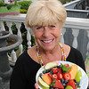 "Marblehead:<br /> Susan Davies makes her specialty ""fruit delight"" for her B&B guests at A Lady Winette Cottage. <br /> Photo by Ken Yuszkus/Salem News, Monday May 18, 2009."