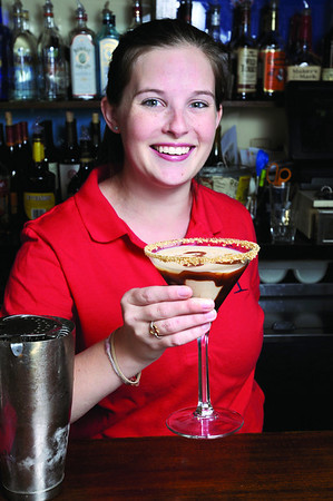 Marblehead:<br /> Brenna Tirrell, bartender at The Landing restaurant, pours a Turtle Dove Martini.<br /> Photo by Ken Yuszkus/Salem News, Monday October 20, 2008.
