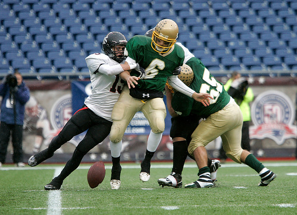 Foxboro: Marblehead Highs Ryan Stanojev brings down Bishop Feehan quarterback Tommy Romero in the first half of play in Div III Superbowl at Gillette Stadium. Photo by Mark Lorenz/Salem News