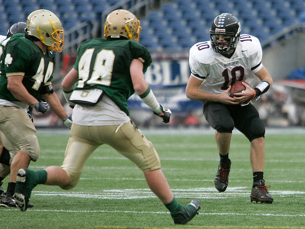 Foxboro: Marblehead Highs quarterback Hayes Richardson looks down field agaisnt Bishop Feehan in the first half of play in Div III Superbowl at Gillette Stadium. Photo by Mark Lorenz/Salem News