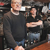 Marblehead:<br /> Phil Sweeney Sr.and Jr. at Sweeney's Retreat. In back of the bar, by the fireplace, chopping cucumbers, and pouring out fish stew.<br /> Photo by Ken Yuszkus/Salem News, Friday,  January 23, 2009.