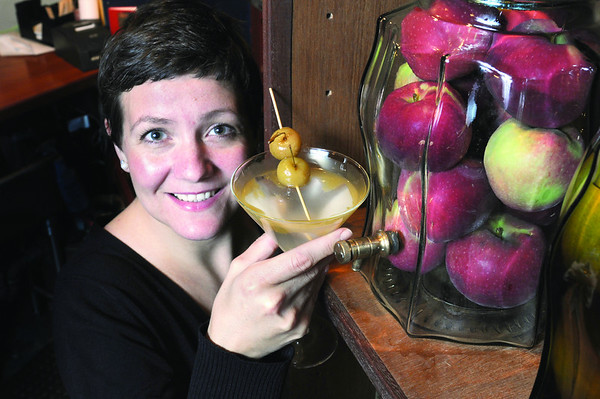 Marblehead:<br /> Emily Farnsworth-Brankman, owner of the Jack - Tarr Restaurant, made the Apple Pie Martini. To the right is a jar of apples sitting in vodka, which is an ingredient for the drink.<br /> Photo by Ken Yuszkus/Salem News, Monday October 20, 2008.