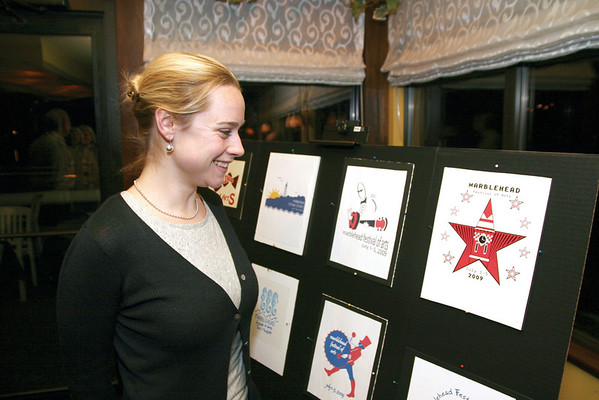 Marblehead:Ê Board member Katherine Koch of Marblehead, admires some of the 70 logo entries, at the Marblehead Festival of Arts Annual Logo Premiere Party, Tuesday, at the Landing Restaurant, Marblehead. Photo by Frank J. Leone, Jr.