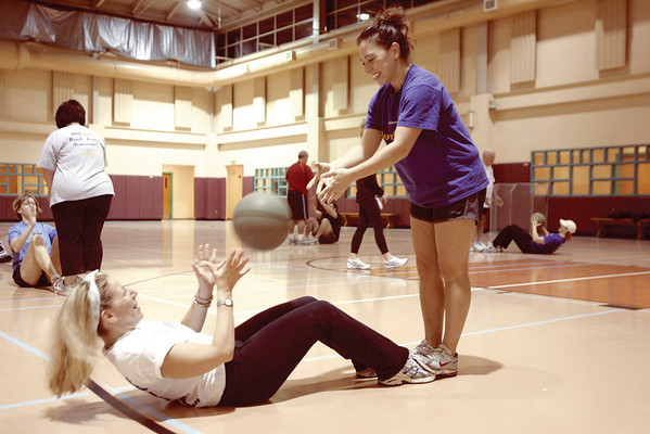Marblehead: Nancy Norman Horrigan, left,  with the help from her partner, Joelle Lydon in their morning workout, at the Marblehead Community Center. The Boot Camp classes are lead by Betsy Caliri. Photo by Mark Lorenz/Salem News