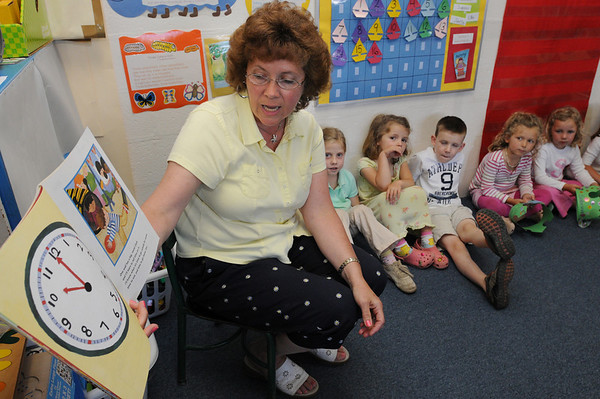 Robin Abel, TK teacher, reads a book to her students. Roseann Phelan has run Seaside Nursery School for more than 35 years, in an old grammar school formerly run by nuns. Many generations of Marblehead residents have attended this school, or her other location, The Children's Center on Tioga Way.<br /> Photo by Ken Yuszkus/Salem News, Tuesday, June 16, 2009.