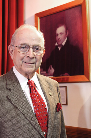 Marblehead:<br /> Retired Judge Joseph Dever stands in Abbot Hall by the portrait of Joseph Story, who was one of Marblehead's most famous attorneys and judges who served on the Supreme Court in the 1800s.<br /> Photo by Ken Yuszkus/Salem News, Friday,  January 9, 2009.