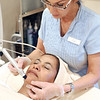 Marblehead:<br /> Dayle Ciampa, owner of Dayle's Day Spa, performs a hydra facial on Nina, a coworker at her business.<br /> Photo by Ken Yuszkus/Salem News, Tuesday,  January 27, 2009.