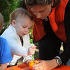 Marblehead:<br /> Karen Corbett helps her daughter Chloe paint a pumpkin/gourd? at a table in the Nicosia backyard.<br /> Photo by Ken Yuszkus/Salem News, Thursday October 8, 2009.