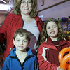 Marblehead: Andrea Mann of Marblehead poses with her children, Noah, 5, left, and Sarah, 11, at the 2009 Marblehead Home and Garden Show at the Marblehead Community Center. Photo by Matthew Viglianti/Staff Photographer March 22, 2009.