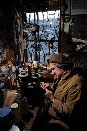 Marblehead:<br /> Carmen Pugliese, of Carmen's Jewelry, places a diamond in the setting of a diamond engagement ring at his shop.<br /> Photo by Ken Yuszkus/Salem News, Tuesday, February 2, 2010.