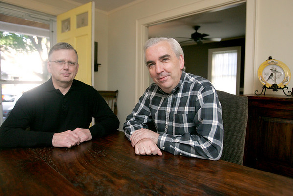 Ken Bowden and his partner Jim Nemeth sit dining room of their Marblehead home. Photo by Deborah Parker/October 7, 2009