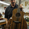 Marblehead:<br /> Bill Tippin holds a finished crescendo guitar that he maked in his shop.<br /> Photo by Ken Yuszkus/Salem News, Friday, July 10, 2009.
