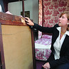 Marblehead:<br /> Liz Clement examines the back of a painting by Mary Bradish Titcomb which was found while searching a closet at the Marblehead Arts Association for hidden forgotten art treasures.<br /> Photo by Ken Yuszkus/Salem News, October 8, 2008.