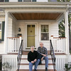 Ken Bowden and his partner Jim Nemeth sit on the front porch of their Marblehead home. Photo by Deborah Parker/October 7, 2009